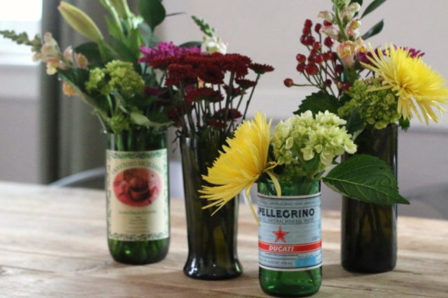 bottles cut into vases and filled with flowers