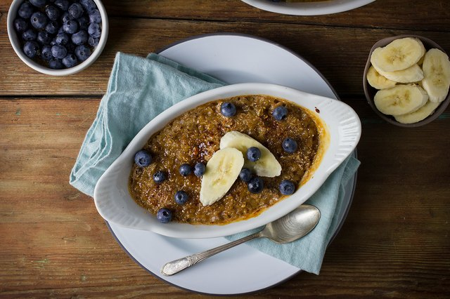 Serving of crisp bruleed oatmeal served with blueberries