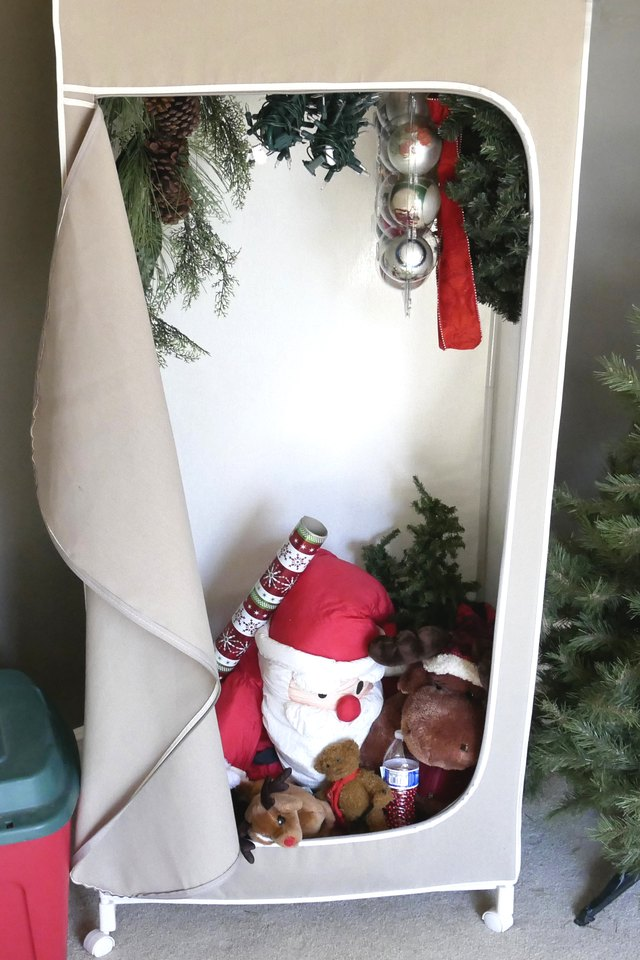 Christmas decorations in portable canvas closet