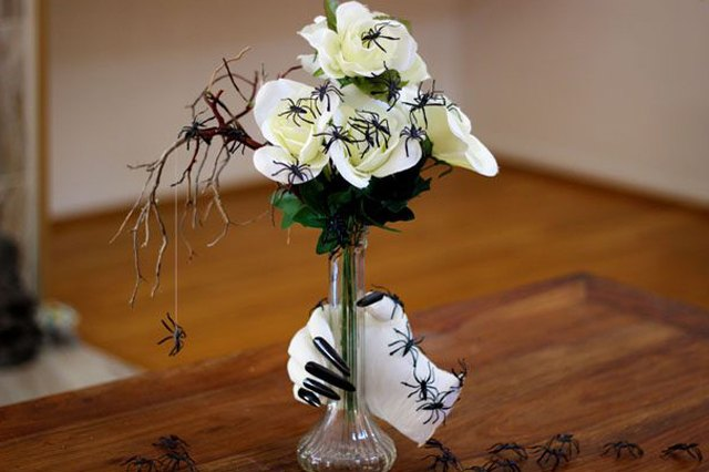 A creepy floral arrangement is a great centerpiece for your frightful Halloween feast.