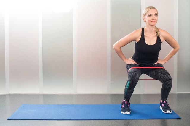 Woman doing yoga to exercise video