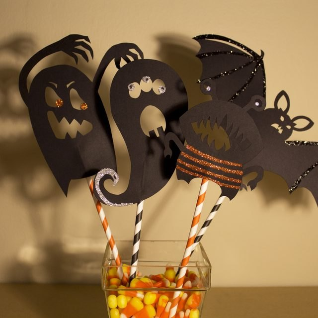 Put on a creepy puppet show or use these shadow puppets as table decor.