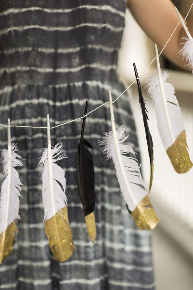 Feather garland with gold tips.