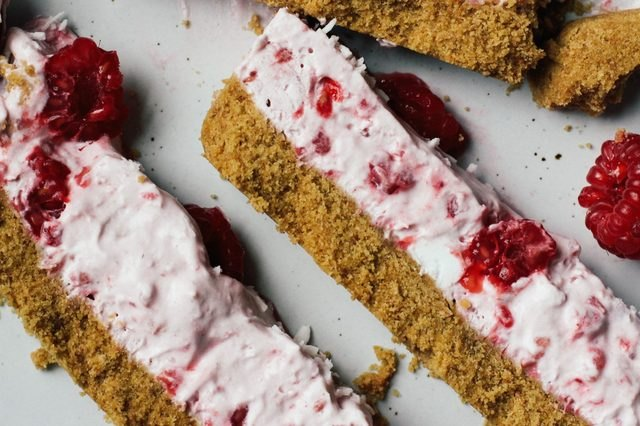 Crumbly raspberry coconut cream bars lying together side-by-side.