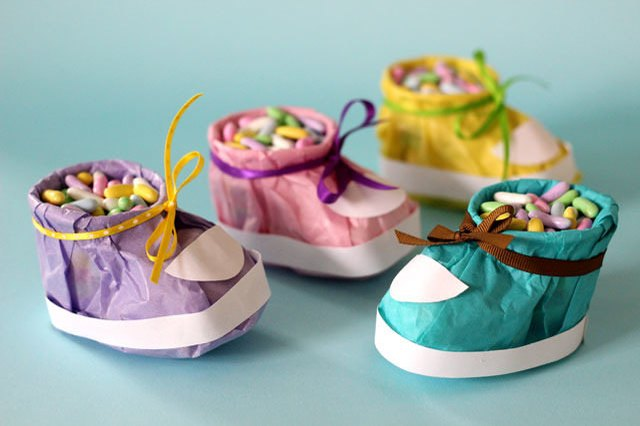 Baby booties made out of tissue paper, filled with candy.