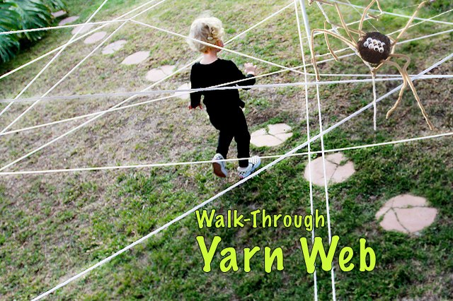 child walking through a web of yarn outside