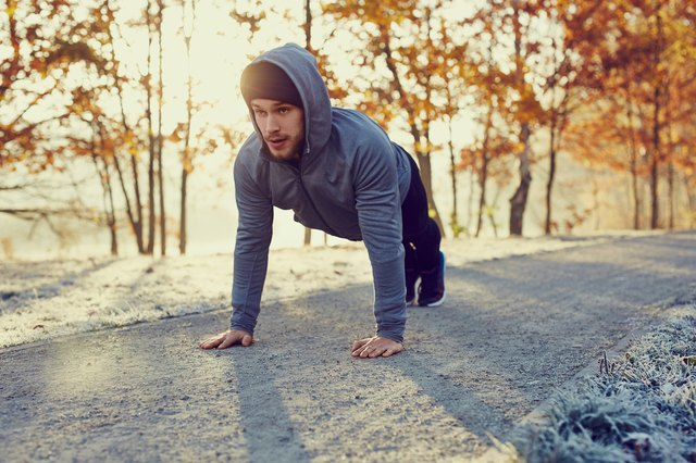 Man working out outside in the winter doing push-ups