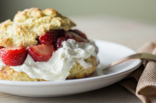 Closeup shot of strawberry shortcake on a small white plate