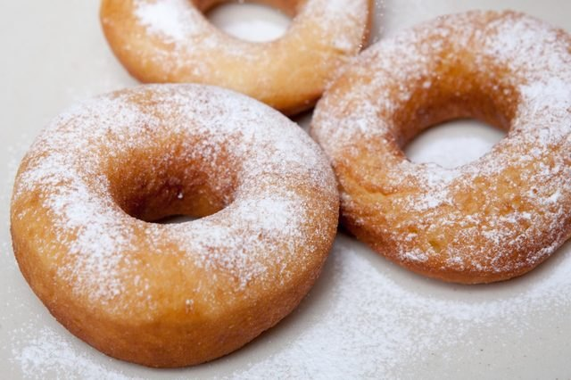 Golden-fried doughnuts sprinkled with granulated sugar