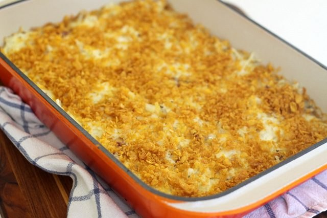 A dish filled with a freshly baked cheesy potato casserole.