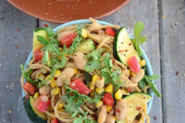 A healthy serving of spicy white bean and zucchini spaghetti.