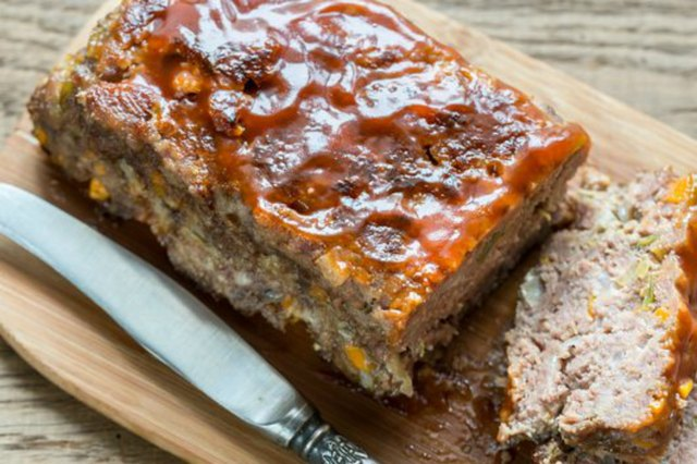Meatloaf with barbecue sauce on the wooden board