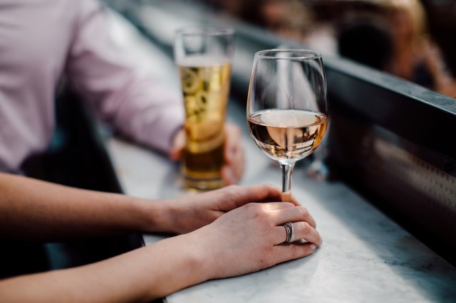 A glass of rose wine as an example of foods that cause bloating