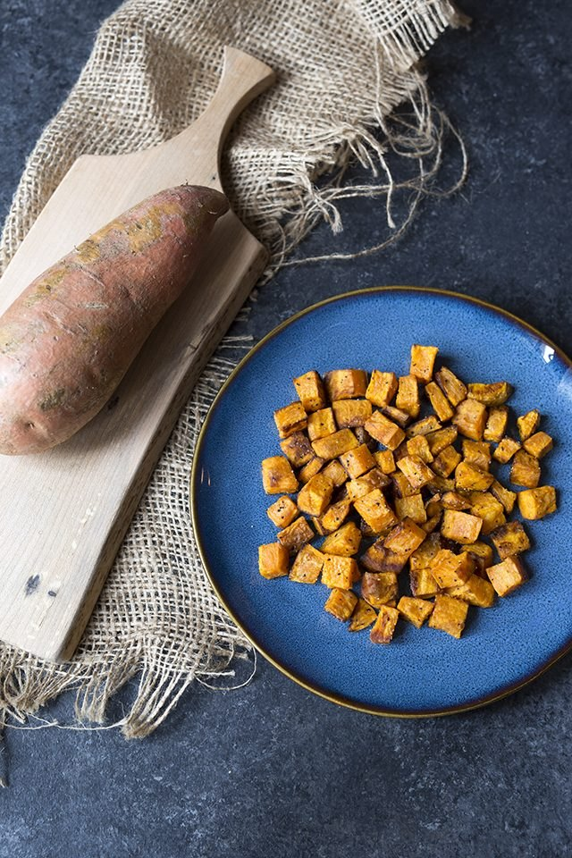 A plate of roasted and diced sweet potatoes.