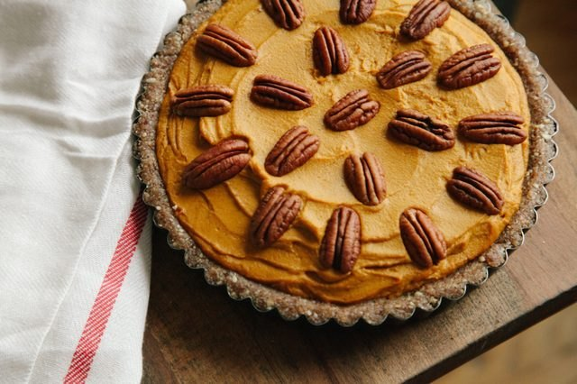 Creamy no-bake pumpkin pie topped with pecans.