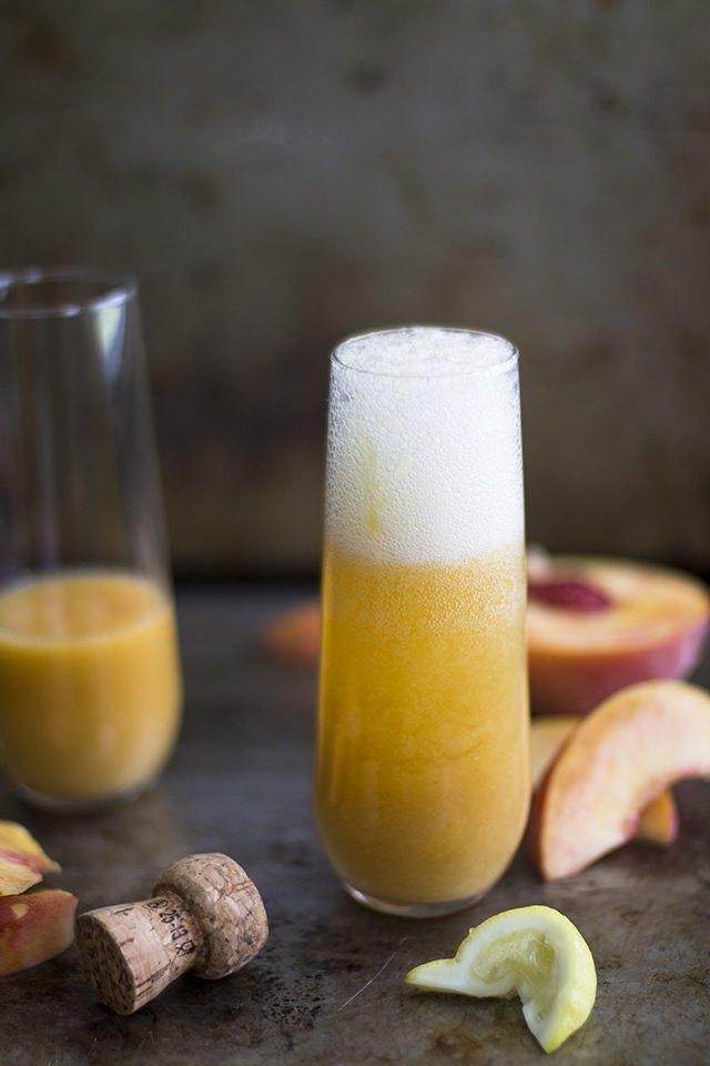 Peach bellini in a stemless champagne glass.