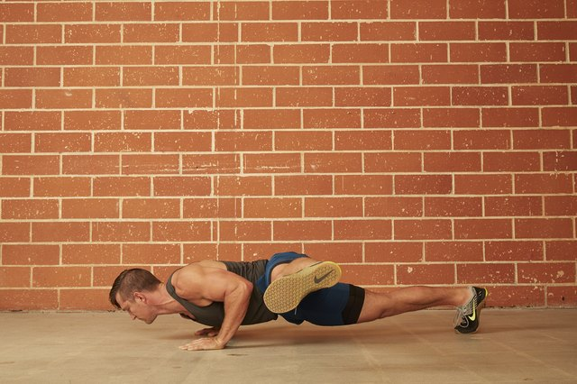 man demonstrating how to do a Outside Leg Kick Push-Up