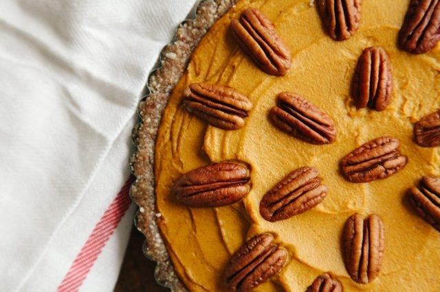 A no-bake pumpkin pie decorated with whole pecans.