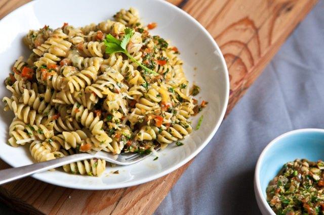 A bowl of fusilli pasta tossed with chipotle cilantro pesto.