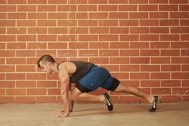 man demonstrating how to do a Knee-to-Chest (Mountain Climber) Push-Up
