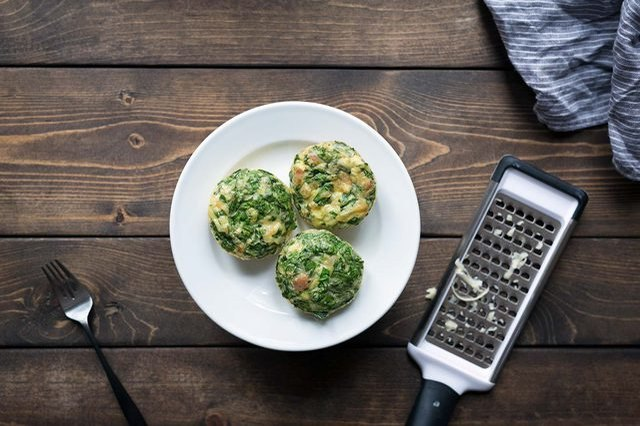 Cheesy eggs baked in a muffin tin and finished with parmesan