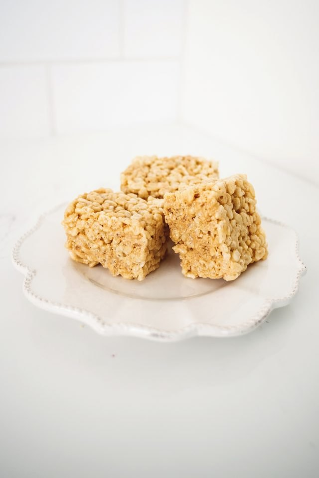 Three squares of soft and chewy rice krispie treats.