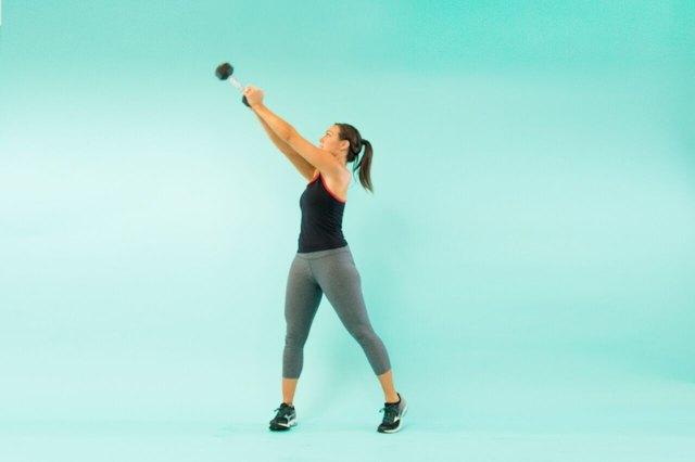 woman doing a wood chop squat