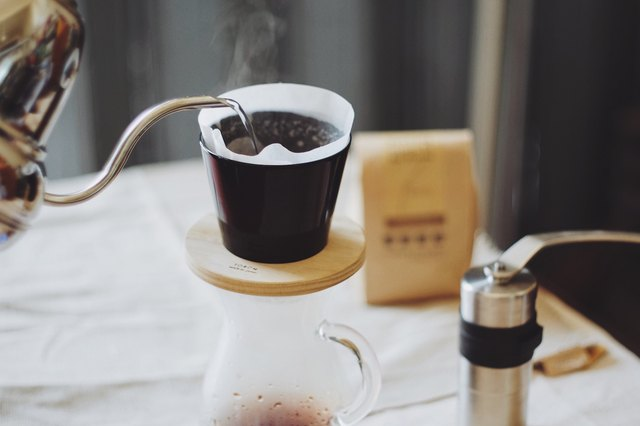 Someone makes pour-over coffee.