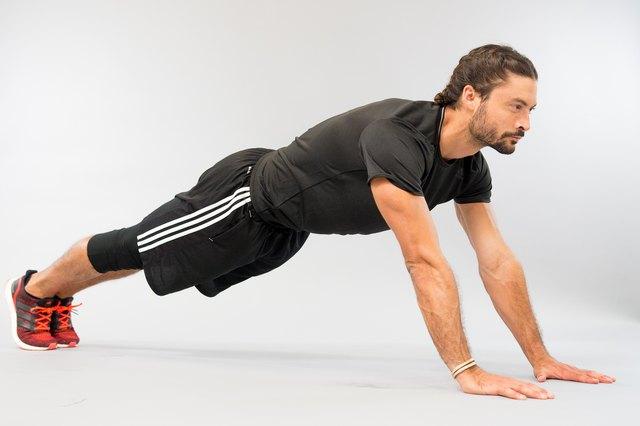 Man performing walking plank