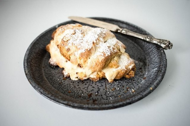 Plate with almond croissant.