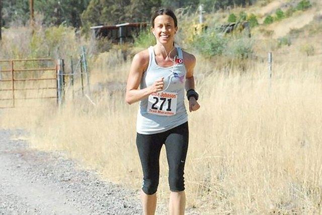 Alanis Morissette running an outdoor trail race