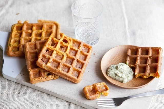 A stack of spicy garbanzo waffles served with mint cilantro chutney.