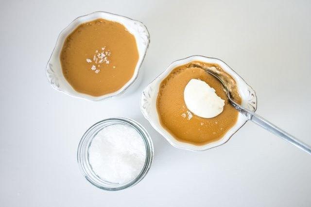 Butterscotch pots de creme served with sea salt and creme fraiche.
