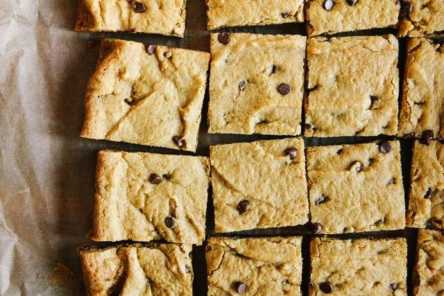 A batch of pumpkin chocolate chip cookie bar squares.