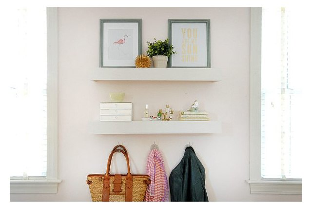 White floating shelves on a wall
