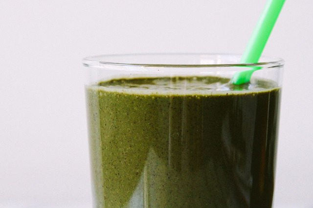 A breakfast smoothie made with berries and leafy greens.