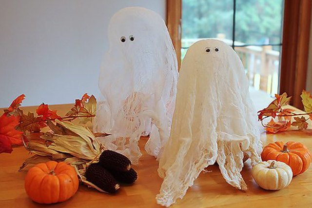 Cheesecloth ghosts make an excellent centerpiece or can be hung from a branch in your yard.