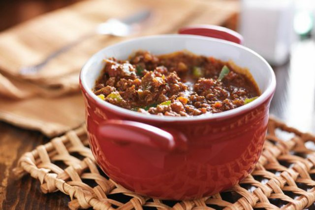 Red dish with meaty beef chili and bell peppers