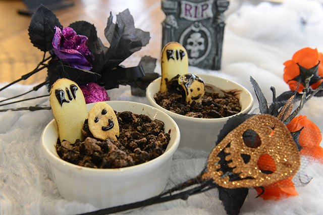 Pudding with cookie tombstones.