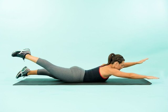 woman doing the Pilates exercise swimming