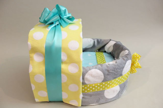 Diaper carriage with baby blankets.