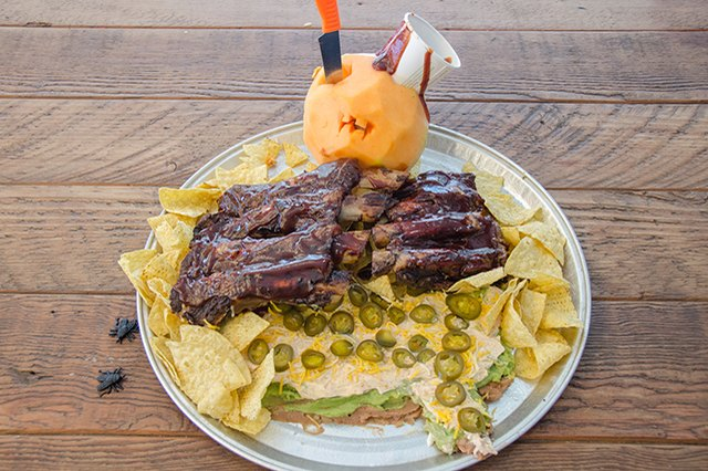 Seven-layer dip covered in ribs.