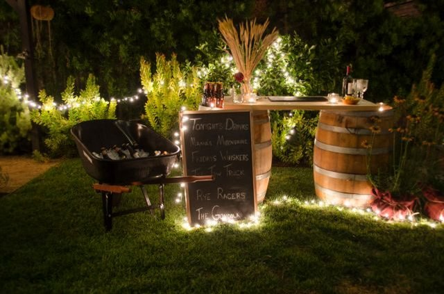 Backyard with outdoor string lights.