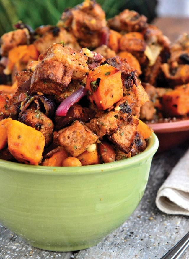 A vibrant bowl of orange sweet potato salad.