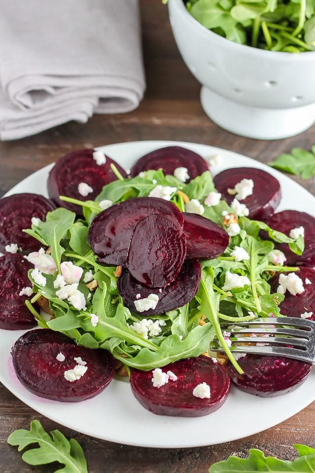 Arugula salad served with deep red beet slices.