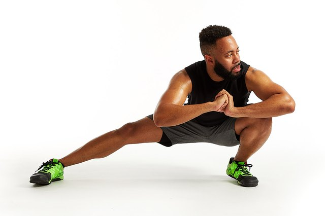 man doing a side lunge stretch