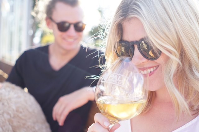 Friends drink wine together