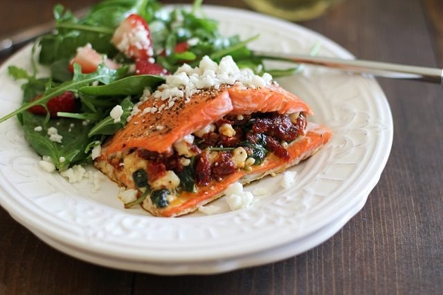 Baked salmon fillets stuffed with a sun-dried tomato mixture, and served with a side salad.
