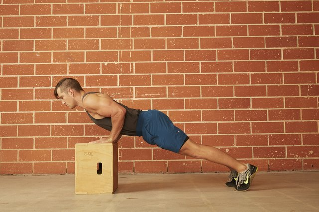 man demonstrating how to do an Incline Push-Up