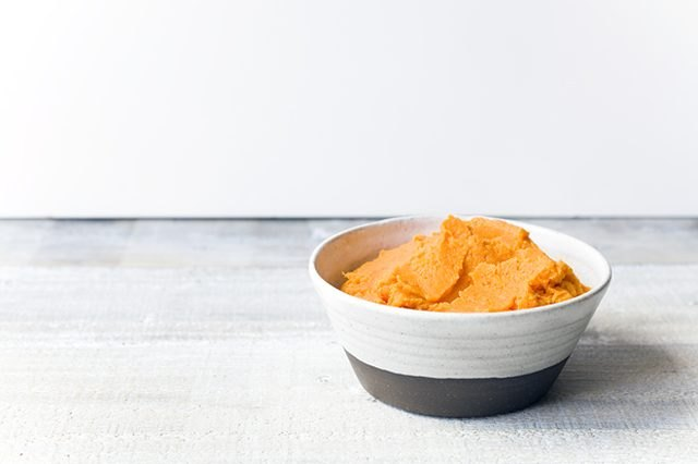 Bowl full of smooth and creamy brown butter mashed sweet potatoes.